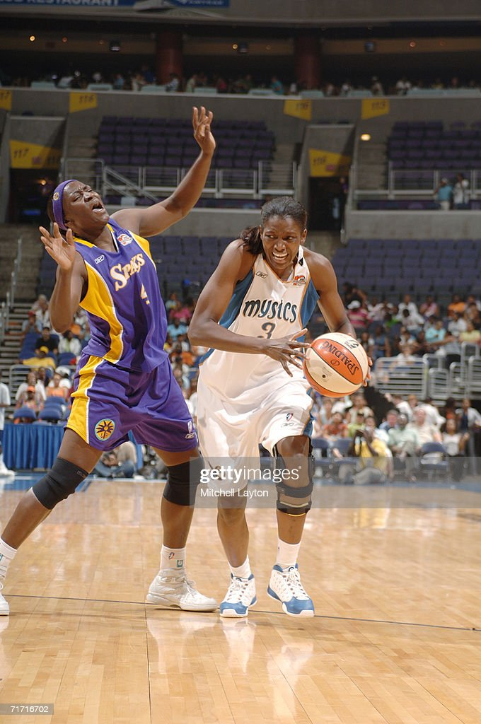 DeLisha Milton-Jones #3 of the Washington Mystics moves the ball against Mwadi Mabika #4 of the Los Angeles Sparks during the game on August 1, 2006 at MCI Center in Washington, D.C. The Mystics won 84-74.