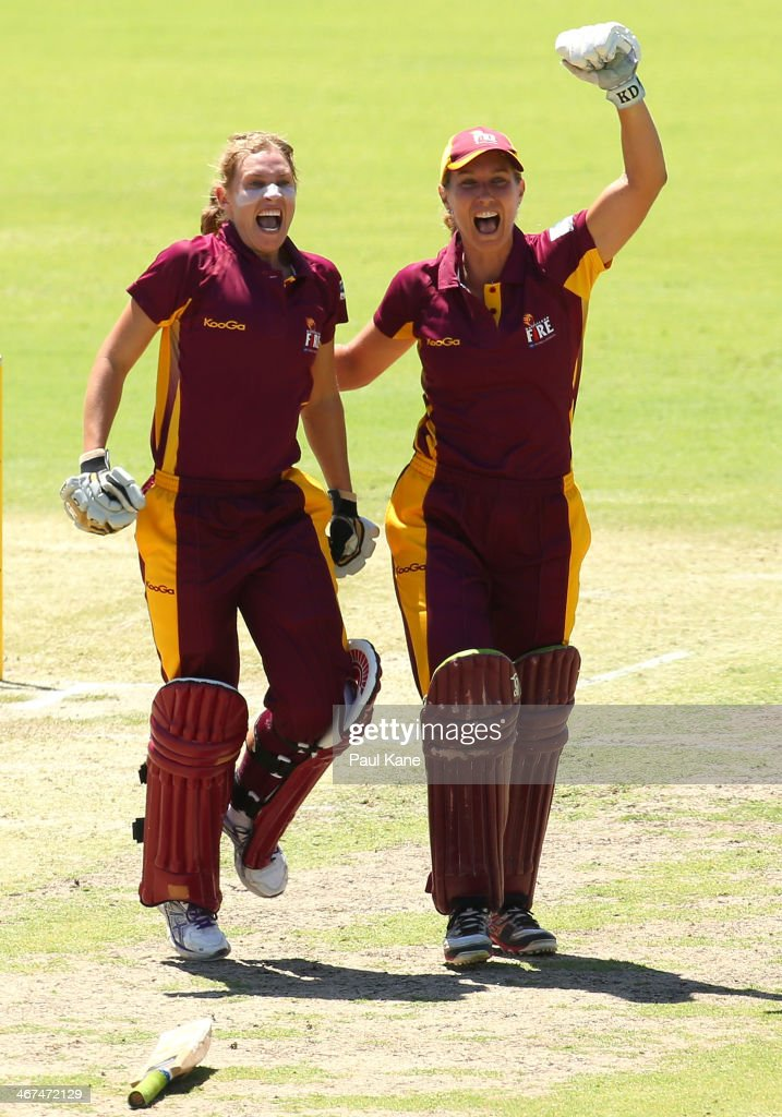 Delissa Kimmince and Melissa Bulow of the Fire celebrate after winning the WT20 Final match between the Queensland Fire and the ACT Meteors at WACA...