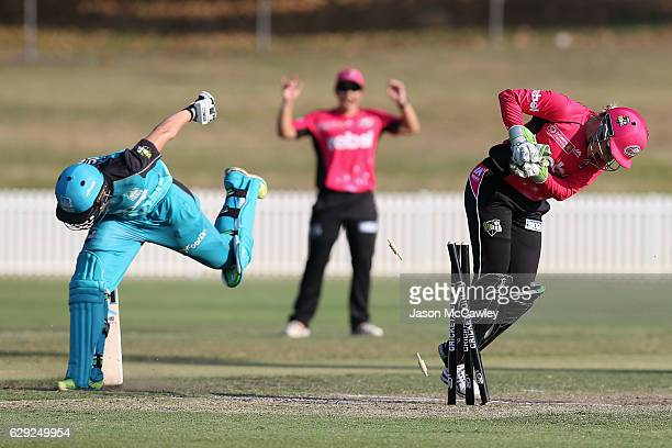 Delissa Kimmince of the Heat is run out during the Women's Big Bash League match between the Brisbane Heat and the Sydney Sixers at Drummoyne Oval on...
