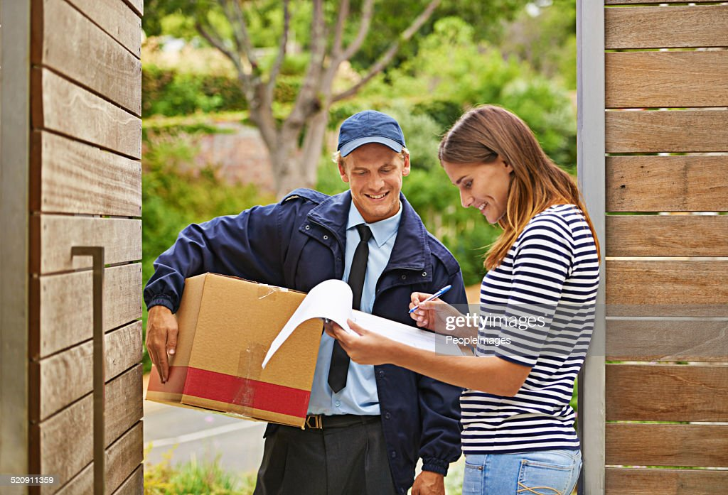 Delivering each package with a smile : Stock Photo