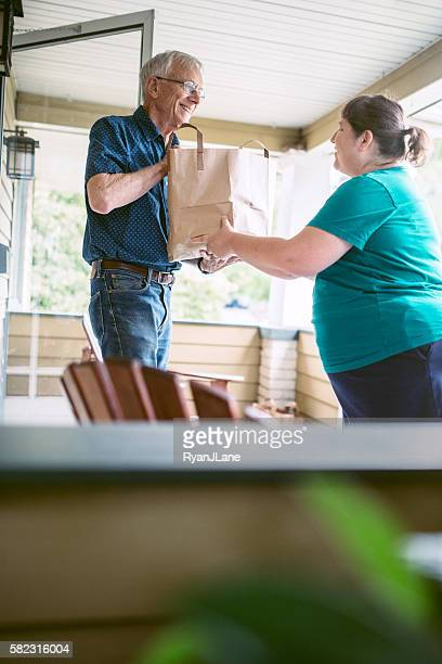 Delivering Groceries To Senior Man
