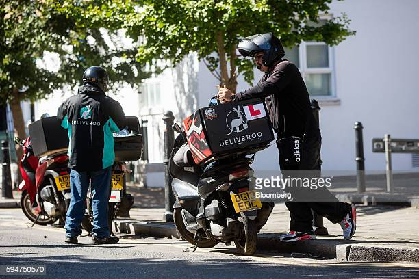 Deliveroo operated by Roofoods Ltd drivers take a break on their scooters in London UK on Monday Aug 22 2016 The sizable amount of money going into...