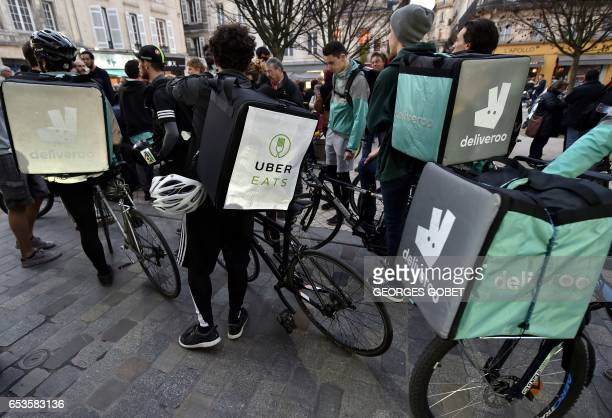 Deliveroo's workers and other 'uberised' bike messengers take part in a demonstration in Bordeaux southwestern France on March 15 2017 on the day of...