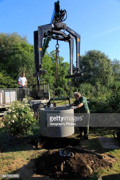 Delivery and installation of concrete ring for domestic septic tank system Suffolk England UK