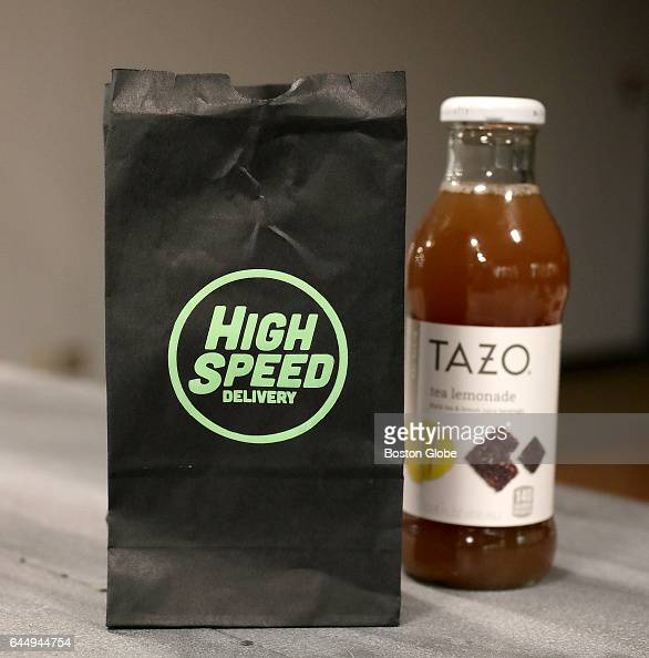 A delivery bag is pictured with a purchased bottle of tea that includes a marijuana gift from High Speed Delivery as delivered to The Boston Globe in...