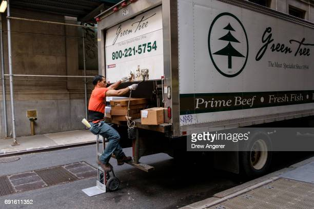 A delivery driver closes the back of his truck June 2 2017 in New York City While US unemployment has hit it lowest level since 2001 at 43 percent...