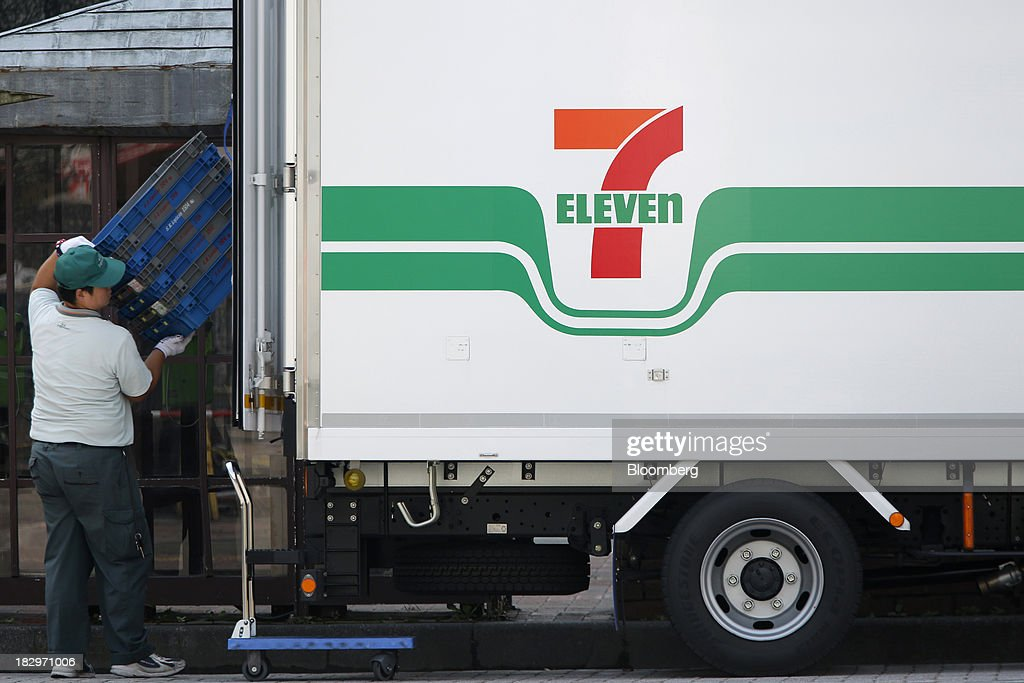 A delivery driver loads empty crates onto a Seven & I Holdings Co. truck bearing the 7-Eleven logo in Soka, Saitama Prefecture, Japan, on Thursday, Oct. 3, 2013. Seven & I reported a 25 percent rise in first-half net income, in line with analysts' estimates. Photographer: Kiyoshi Ota/Bloomberg via Getty Images