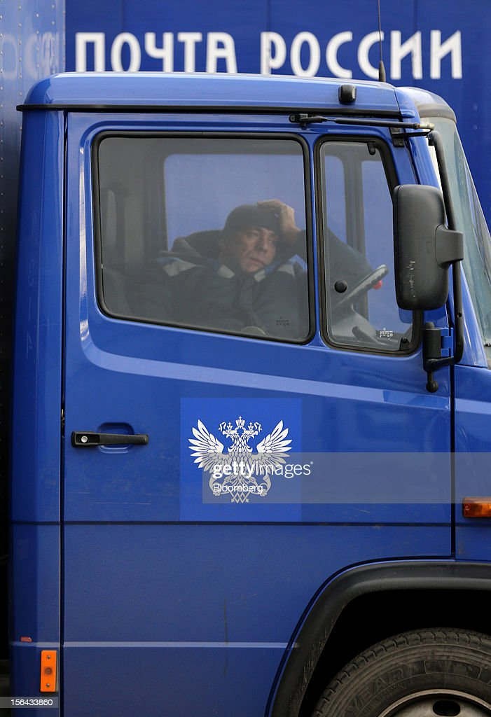 A delivery driver waits in his cab outside the Russian Post automated sorting center in Podolsk, Russia, on Wednesday, Nov. 14, 2012. Alexander Kiselev, Russian Post's chief executive officer, needs to invest 200 billion rubles through 2020 to turn around a company that described its infrastructure as 'the most expansive, but the least efficient' in a strategy plan this year. Photographer: Andrey Rudakov/Bloomberg via Getty Images