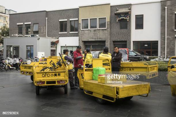 Delivery drivers for Ofo Inc bicycles stand with their trucks outside a subway station in Beijing China on Tuesday Oct 17 2017 President Xi Jinping...