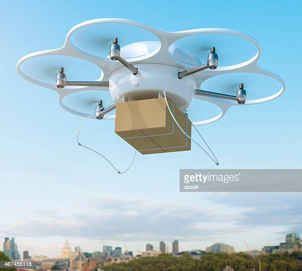 Delivery drone carrying package on a city