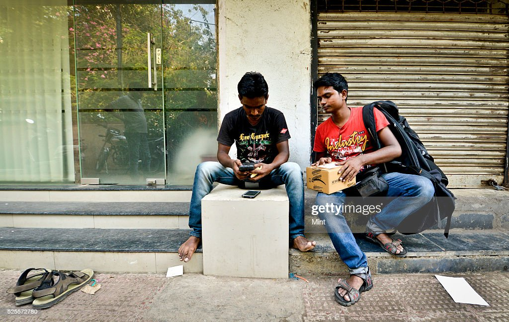 Delivery guys switched from DTDC courier company to Amazon, which has been offering better salary from other courier companies on May 5, 2015 in Mumbai, India.