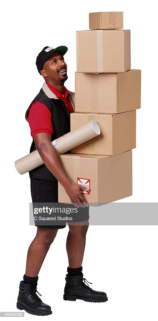 Delivery Man Carrying a Stack of Boxes : Stock Photo