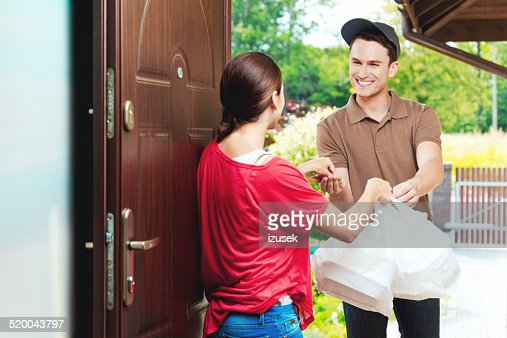 Delivery man delivering chinese take away food