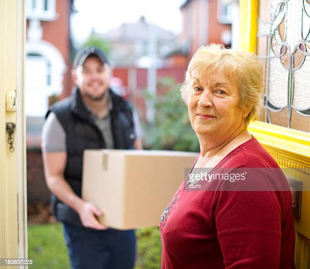 Delivery man delivering gran her parcels