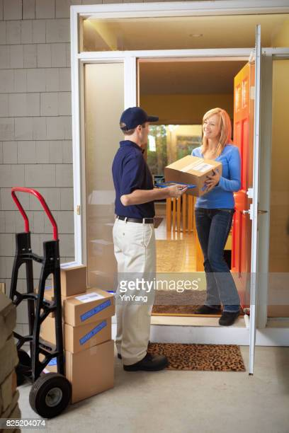 Delivery Man Delivering Package to Woman Customer at the Door