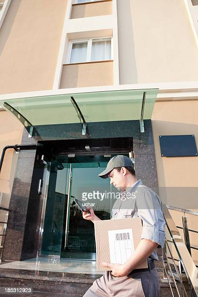 delivery man looking tablet pc screen