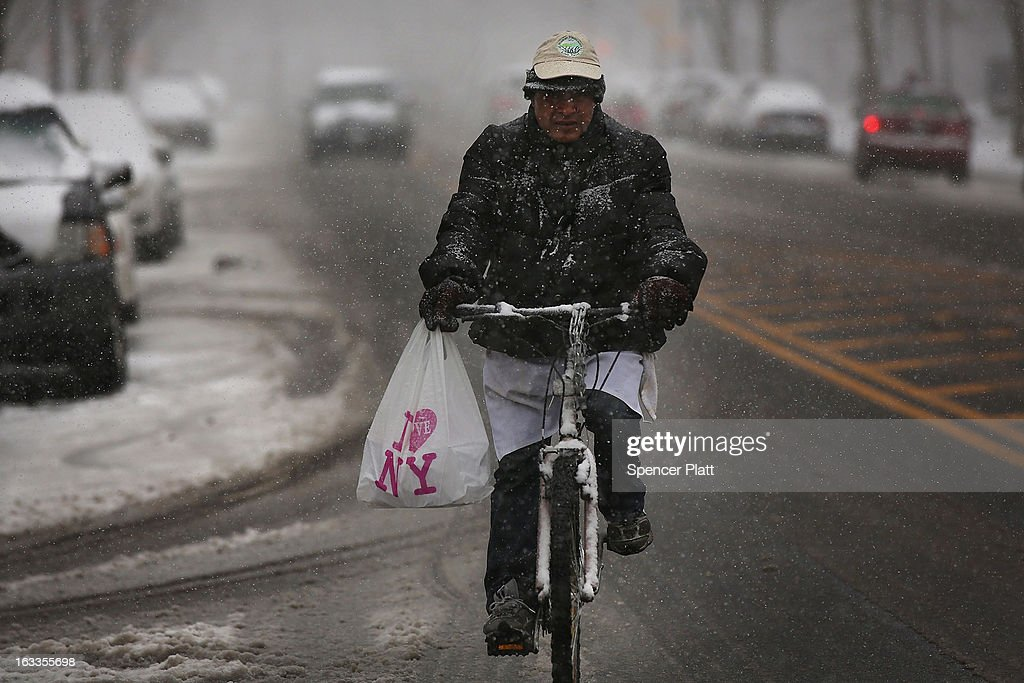 A delivery man navigates the snow on a bicycle on March 8, 2013 in the Brooklyn borough of New York City. As a week-old storm slowly moves out to sea, the New York City area is expecting 1 to 3 inches of snow with more in areas north and west of the city. The storm has caused flight delays at area airports and numerous schools have delayed start times.