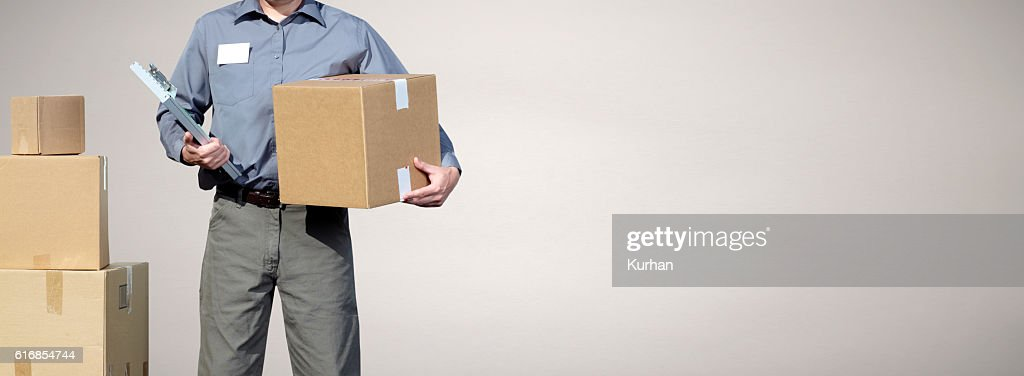 Delivery man with a parcel. : Stock Photo