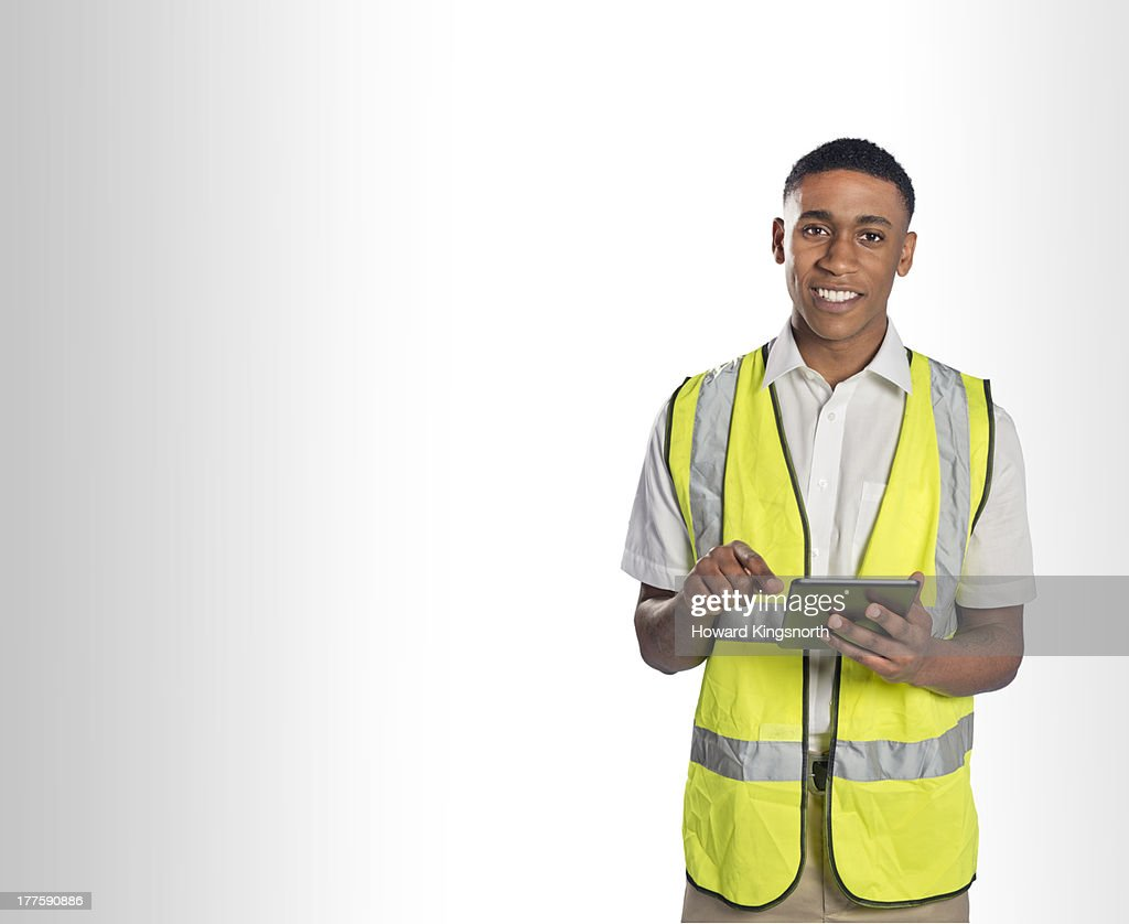 delivery man with tablet : Stock Photo