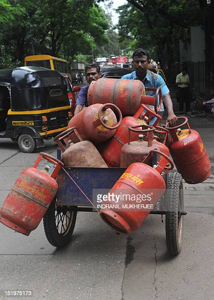 Delivery men ferry empty LPG cylinders to a warehouse in Mumbai on September 14 2012 India's government was confronted by strike threats and a...