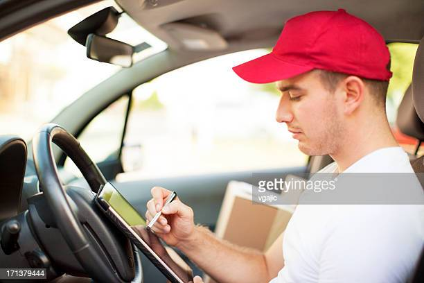 Delivery person inside of a vehicle.