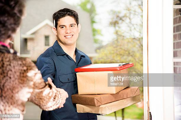 Delivery service. Latin descent man delivers packages to home. Customer.