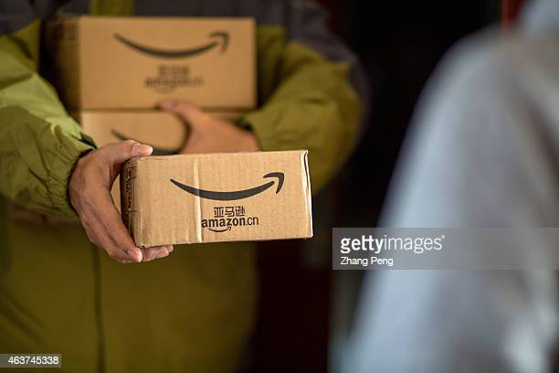 A delivery staff of Amazoncn sends goods to a customer Amazon the US ecommerce group is struggling to competing with Chinese rivals Alibaba and JDcom
