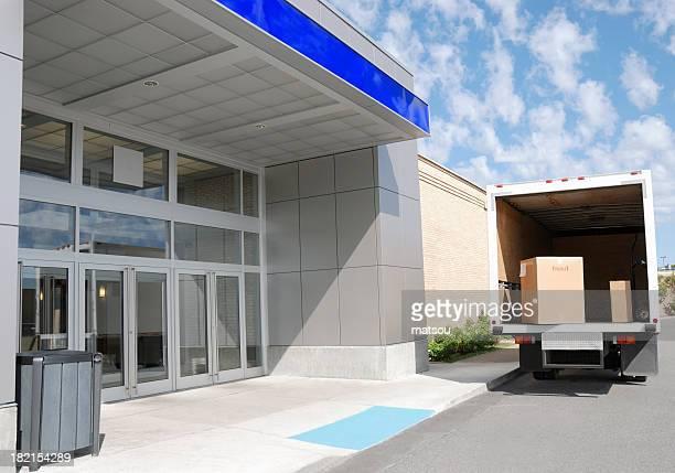 Delivery truck at building door