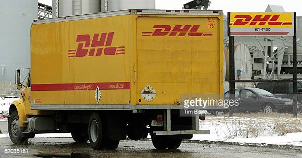 DHL delivery truck drives outside a DHL facility January 19 2005 in Franklin Park Illinois DHL a unit of Germany's Deutsche Post bought AirBorne...