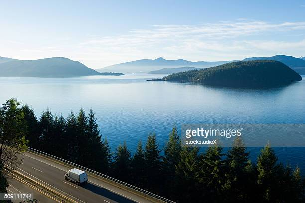 Delivery truck driving along Highway 99, BC, Canada