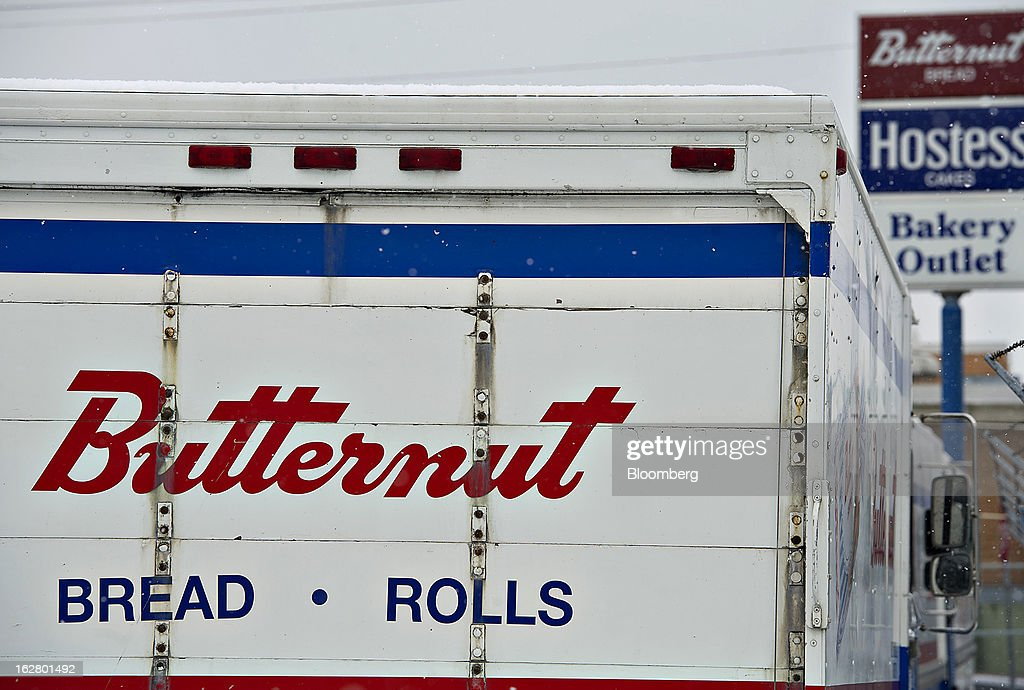 A delivery truck sits outside an idled Hostess Brands Inc. bakery in Peoria, Illinois, U.S., on Wednesday, Feb. 27, 2013. Flowers Foods Inc., maker of packaged bakery foods, won the bidding for the majority of the bread-making business of Hostess Brands Inc., including the Wonder, Butternut, Home Pride, Merita and Nature's Pride brands, 20 bread plants, 38 depots and other assets, after no other competing offers were submitted. Photographer: Daniel Acker/Bloomberg via Getty Images