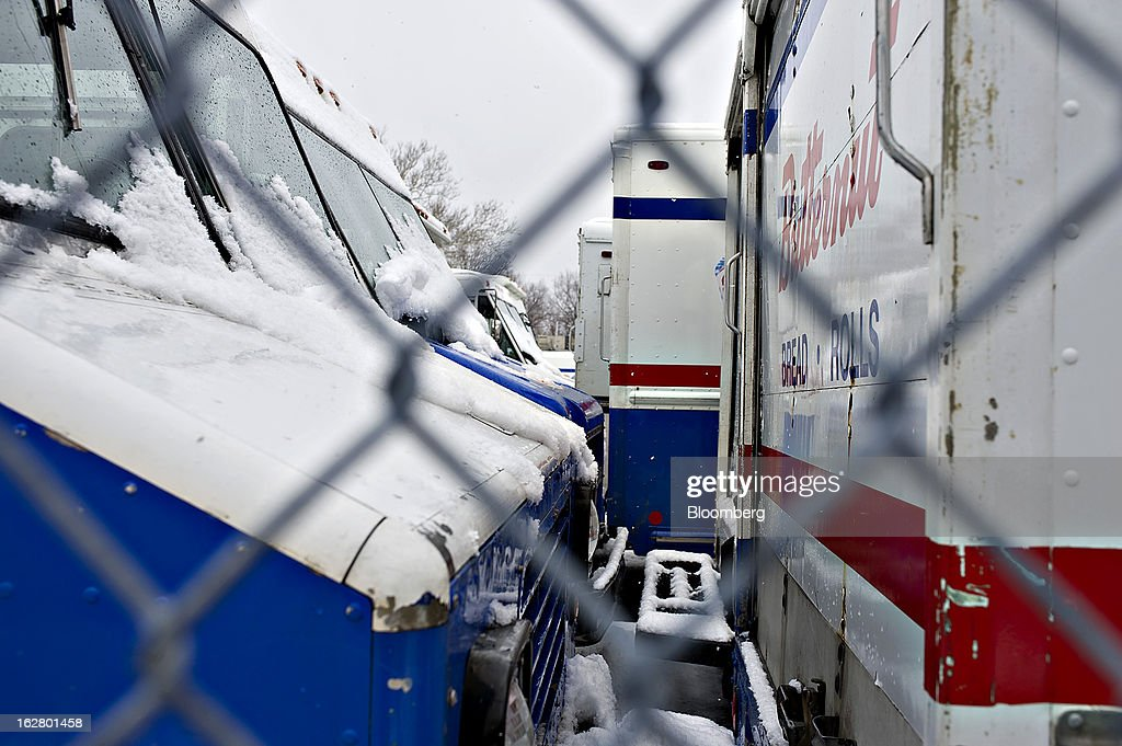 Delivery trucks sit outside an idled Hostess Brands Inc. bakery in Peoria, Illinois, U.S., on Wednesday, Feb. 27, 2013. Flowers Foods Inc., maker of packaged bakery foods, won the bidding for the majority of the bread-making business of Hostess Brands Inc., including the Wonder, Butternut, Home Pride, Merita and Nature's Pride brands, 20 bread plants, 38 depots and other assets, after no other competing offers were submitted. Photographer: Daniel Acker/Bloomberg via Getty Images