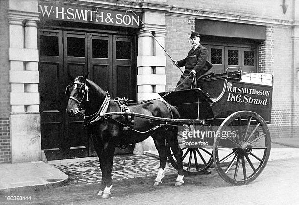 A delivery van and driver for W H Smith Son stationers booksellers and newsagents circa 1910