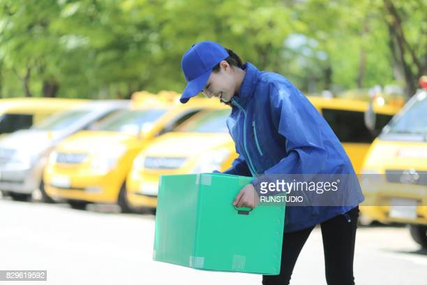 Delivery woman holding a package