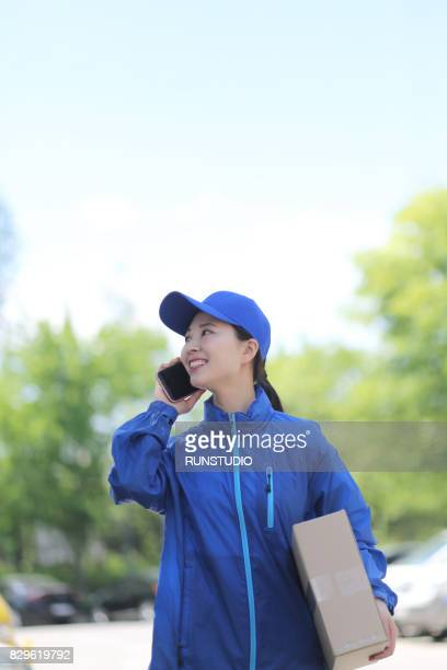 delivery woman talking on cell phone