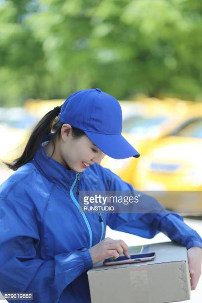 delivery woman using mobile phone