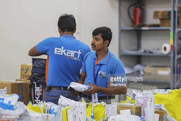 Deliveryman known as Wishmasters for Flipkart Online Services Pvt's Ekart Logistics service sort packages at the company's office in the Jayaprakash...
