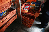 A deliveryman places Grupo Bimbo SAB snacks on a crate for an order in Mexico City Mexico on Thursday July 21 2016 Grupo Bimbo SAB is scheduled to...