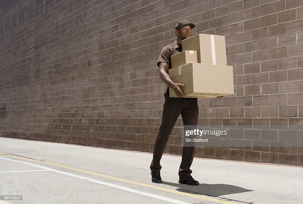 delivery person, die Boxen : Stock-Foto