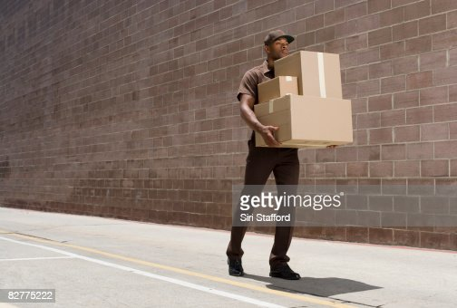 delivery-person carrying boxes