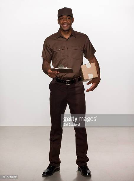 delivery-person with box and clipboard