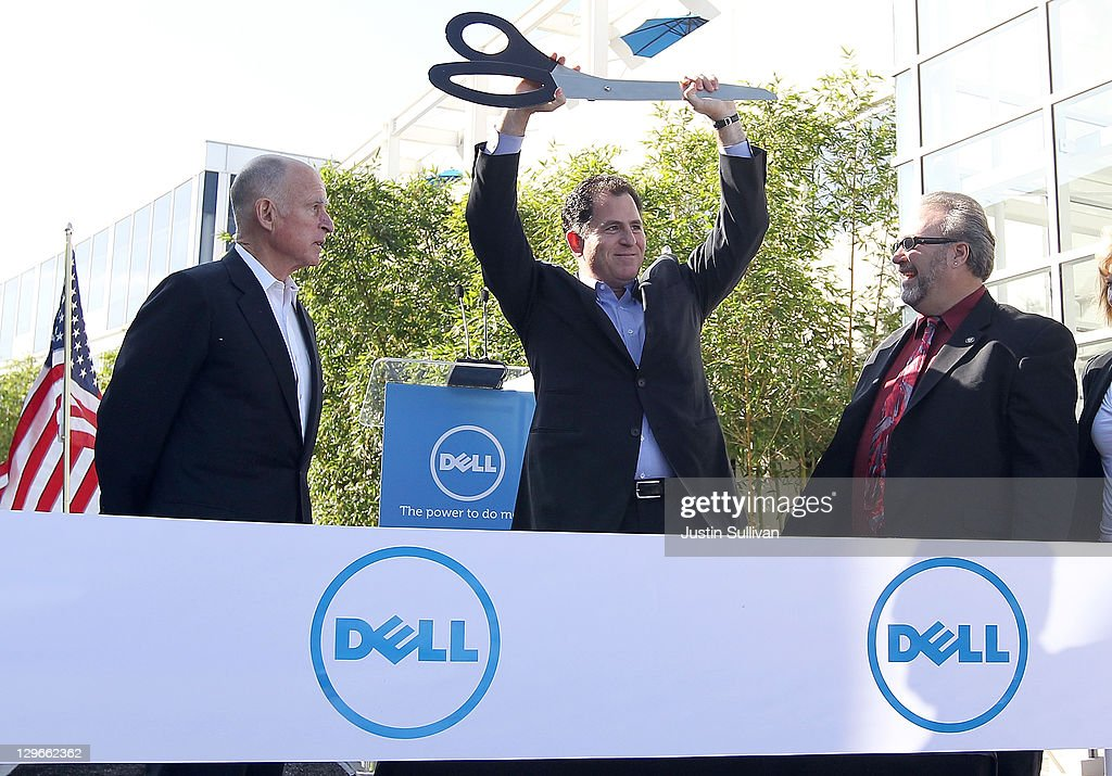 Dell chairman and CEO <a gi-track='captionPersonalityLinkClicked' href=/galleries/search?phrase=Michael+Dell&family=editorial&specificpeople=240605 ng-click='$event.stopPropagation()'>Michael Dell</a> (C) holds up a giant pair of scissors as California governor <a gi-track='captionPersonalityLinkClicked' href=/galleries/search?phrase=Jerry+Brown&family=editorial&specificpeople=217599 ng-click='$event.stopPropagation()'>Jerry Brown</a> (L) and Santa Clara mayor Jamie Matthews (R) look on during a ribbon cutting ceremony to open the new Dell research and development facility on October 19, 2011 in Santa Clara, California. California governor <a gi-track='captionPersonalityLinkClicked' href=/galleries/search?phrase=Jerry+Brown&family=editorial&specificpeople=217599 ng-click='$event.stopPropagation()'>Jerry Brown</a> and Dell Chairman and CEO <a gi-track='captionPersonalityLinkClicked' href=/galleries/search?phrase=Michael+Dell&family=editorial&specificpeople=240605 ng-click='$event.stopPropagation()'>Michael Dell</a> attended a ribbon cutting to open the new Dell research and development facility that was followed by a career fair to hire hundreds of employees for the new facilty.