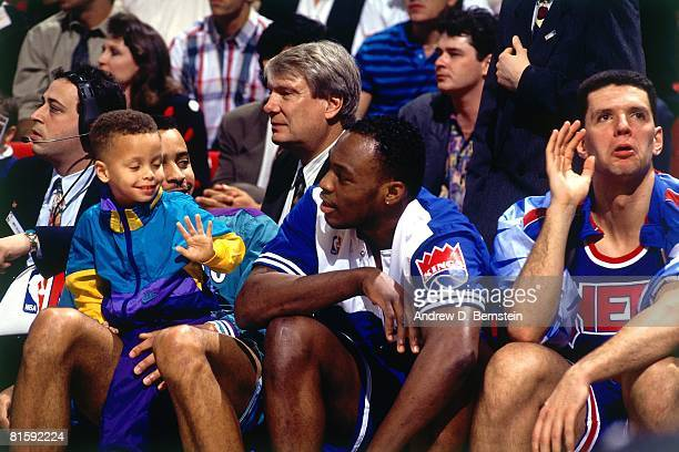 Dell Curry of the Charlotte Hornets and his son Stephen Curry sit with Mitch Richmond of the Sacramento Kings and Drazen Petrovic of the New Jersey...
