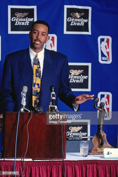 Dell Curry of the Charlotte Hornets speaks at the podium after being presented the 19931994 NBA Sixth Man of the Year Award on May 12 1994 at the...