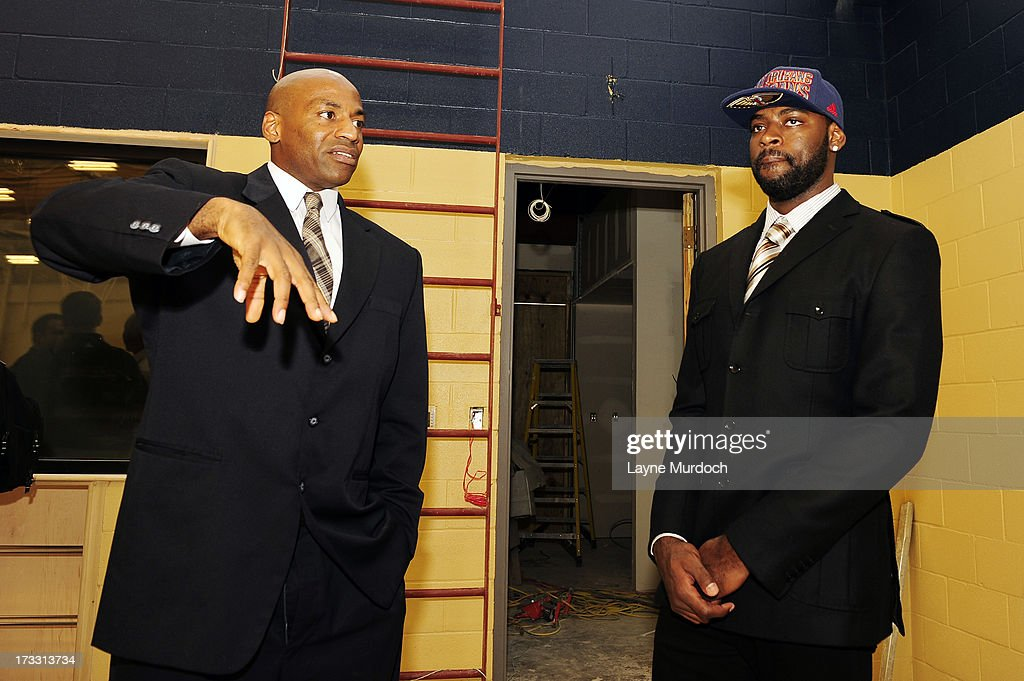 Dell Demps, general manager of the New Orleans Pelicans takes Tyreke Evans on a tour of the Pelicans new practice facility after the team acquired Evans through a three team trade on July 11, 2013 at the New Orleans Pelicans Headquarters in Metairie, Louisiana.