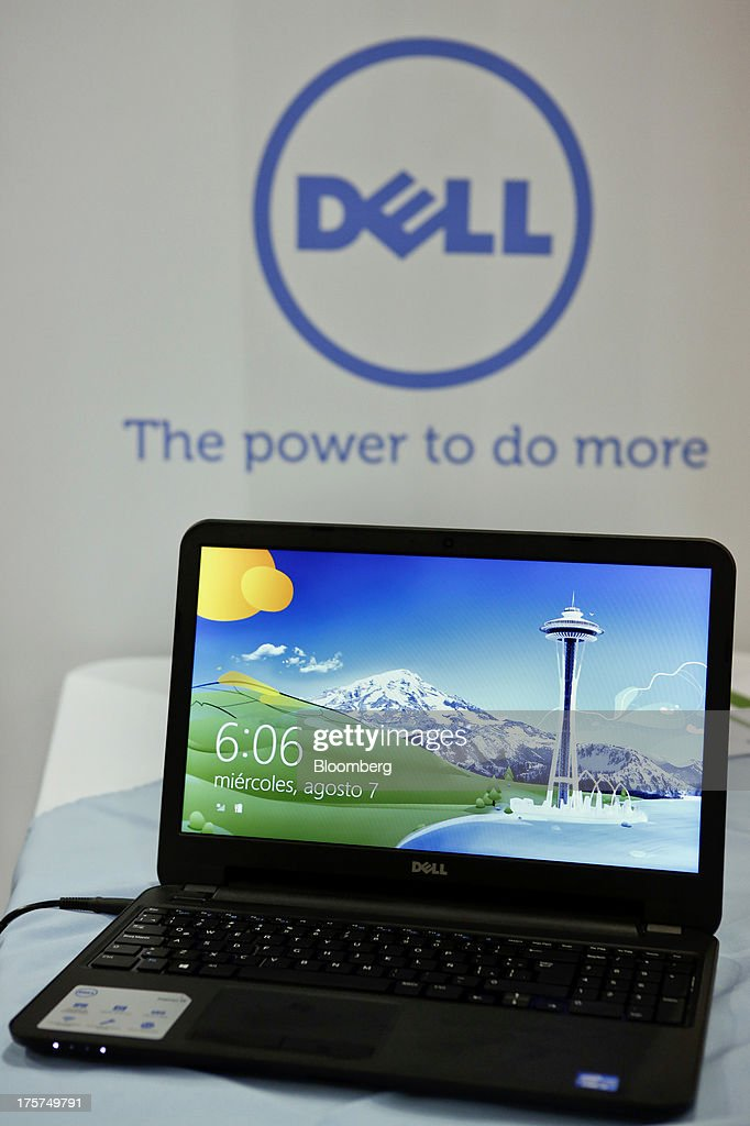 A Dell Inc. Inspiron 15 laptop is displayed during an event at a Curacao Department store in Los Angeles, California, U.S., on Wednesday, August 7, 2013. The Inspiron 15, an affordable notebook with an impressive battery life, is the only Spanish-language laptop manufactured and sold in the U.S. offered by Dell. Photographer: Patrick T. Fallon/Bloomberg via Getty Images