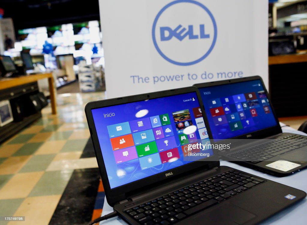 Dell Inc. Inspiron 15 laptops are displayed during an event at a Curacao Department store in Los Angeles, California, U.S., on Wednesday, August 7, 2013. The Inspiron 15, an affordable notebook with an impressive battery life, is the only Spanish-language laptop manufactured and sold in the U.S. offered by Dell. Photographer: Patrick T. Fallon/Bloomberg via Getty Images