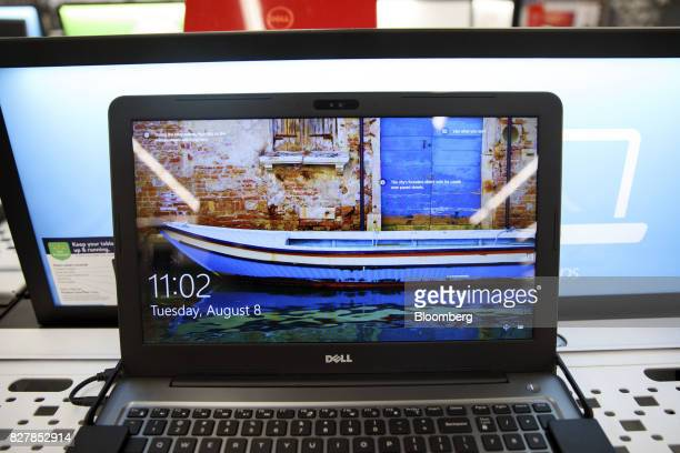 A Dell Inc laptop is displayed for sale at a WalMart Stores Inc location in Burbank California US on Tuesday Aug 8 2017 WalMart Stores is scheduled...