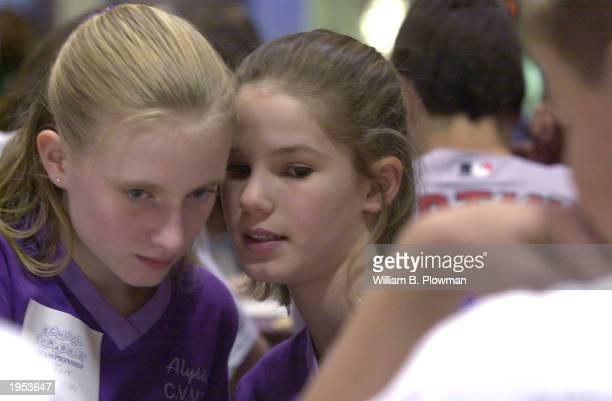 Della Anderson and teammate Alyssa Farr of Oregon plan their next move while they participate in the National School Scrabble Tournament April 26...