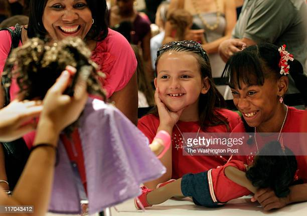 Della Laster Ashley White 7 years old and Dana Laster 9 years old react as they see Laster's doll hair done at the new American Girl in McLeanVA on...